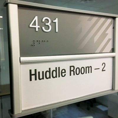 Hub geometric example - A room number tag with the geometric design on the right of the tag.