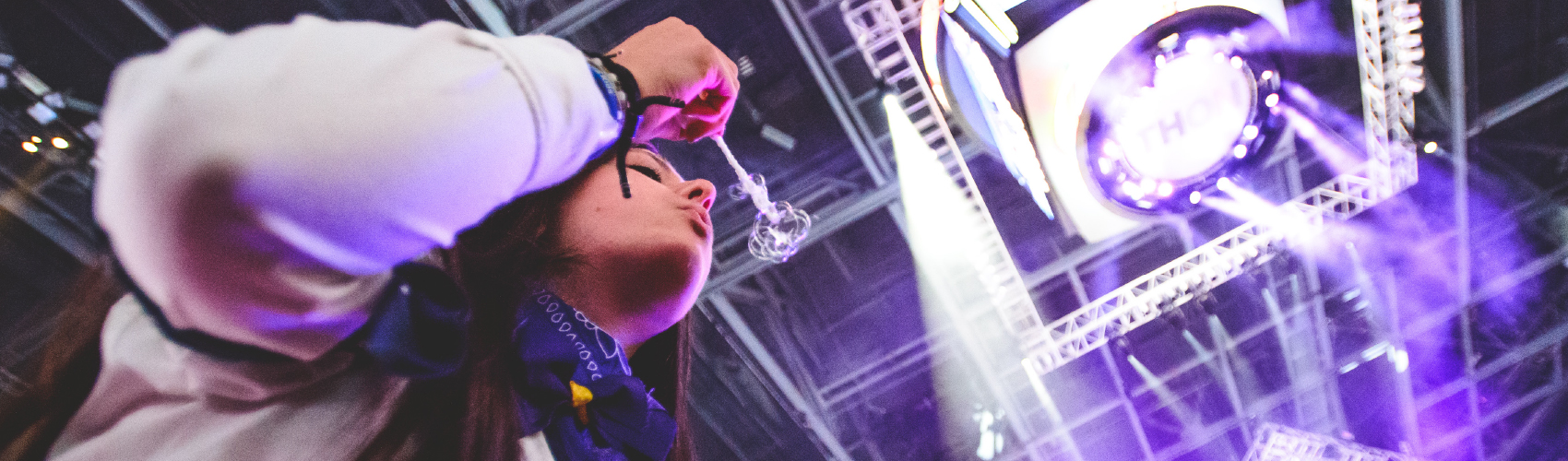 Student blowing bubble at THON